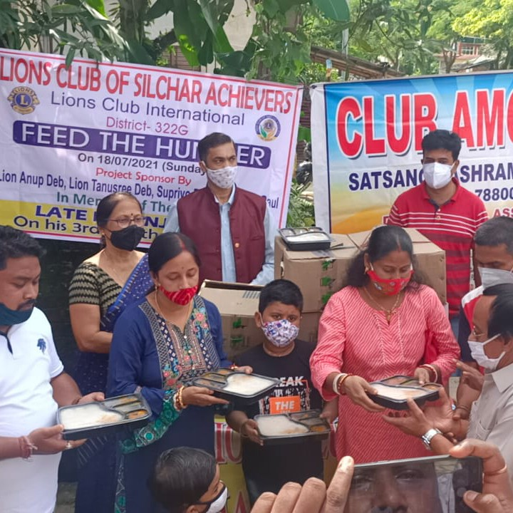 Food distribution by Lions Club of Silchar Achievers at Ashram Road